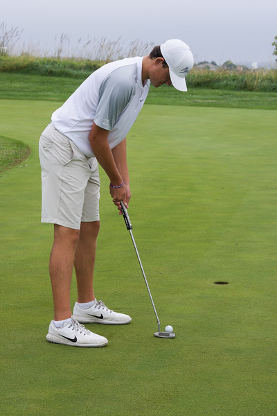 Will Hopkins, a freshman in business administration, works on perfecting his putting stroke and alignment on the green before a Friday afternoon practice round. This event took place at 3 p.m. on Oct. 5, at Colbert Hills Country Club. (Brooke Barrett | Collegian Media Group)