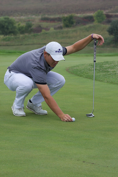 Ben Fernandez, a senior in finance, carefully reads his putt before playing a practice round at Colbert Hills Country Club. This event took place at 3 p.m. on Oct. 5. (Brooke Barrett | Collegian Media Group)