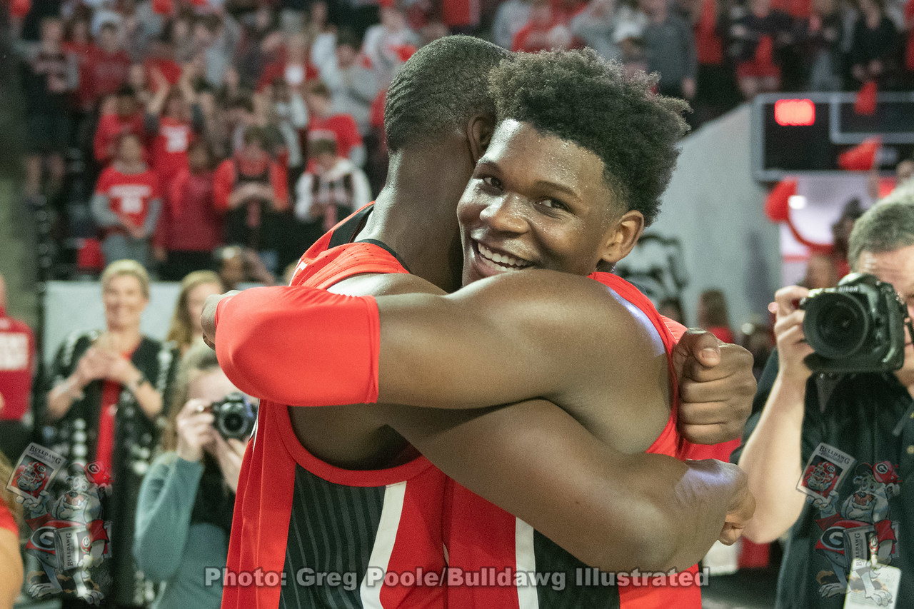 UGA men's basketball Anthony Edwards (5) shares a moment with a teammate after the Bulldogs upend No. 13 Auburn, 65-55, on Wednesday in the Stege | February 19, 2020