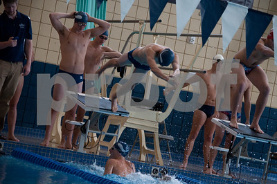 Johnathon Purdy finishing in water Royce Dingley diving Cameron Grant behind block Marko Karaulic behind Cameron