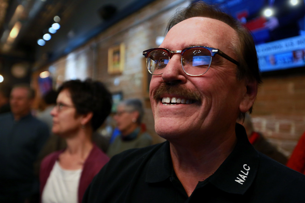. Campaign manager Gil Barela smiles as he gazes upon the first election results that showed ballot issue 1A ahead by a wide margin on Tuesday, Nov. 6, 2018 at the Loveland TapHouse in Loveland Colo.  Photo by Taelyn Livingston/ Loveland Reporter Herald