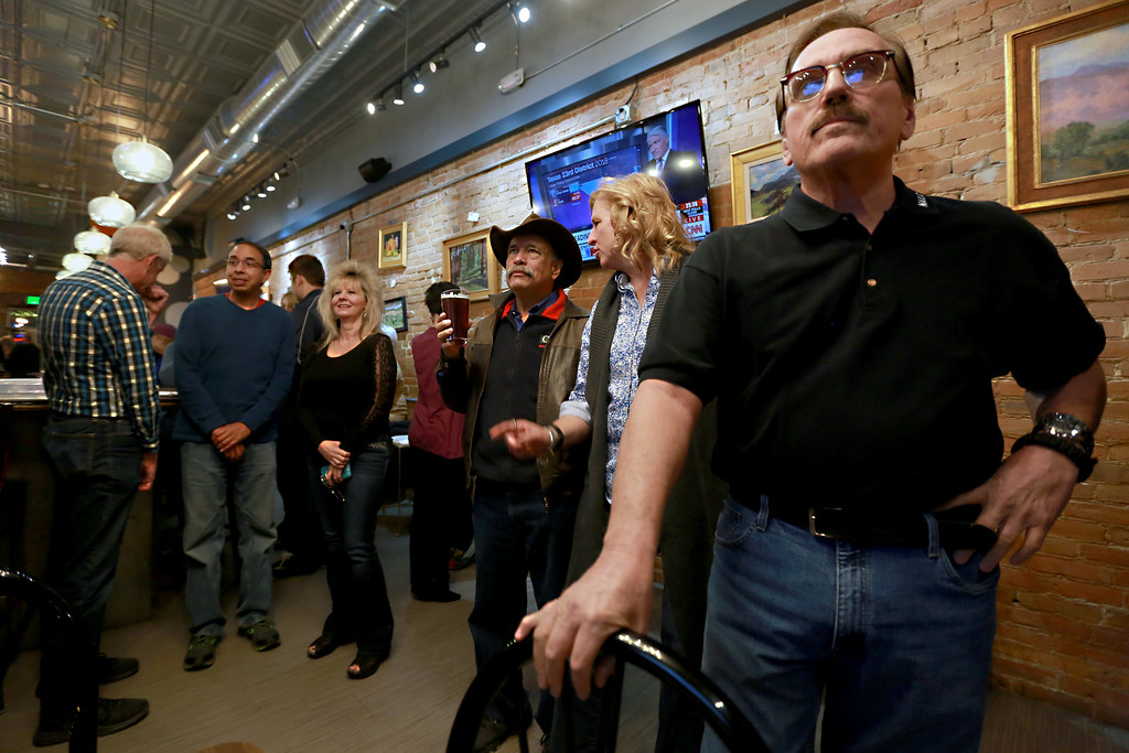 . Campaign manager Gil Barela waits for the results for ballot issue 1A  on Tuesday Nov. 6, 2018 in Loveland Colo. at the Loveland TapHouse. Waiting behind him from left are Larimer County Commissioner Steve Johnson, Matt Villalovos, Darla Barela, Fred Garcia and Jody Shadduck-McNally and Michael Allen. Photo by Taelyn Livingston/ Reporter-Herald