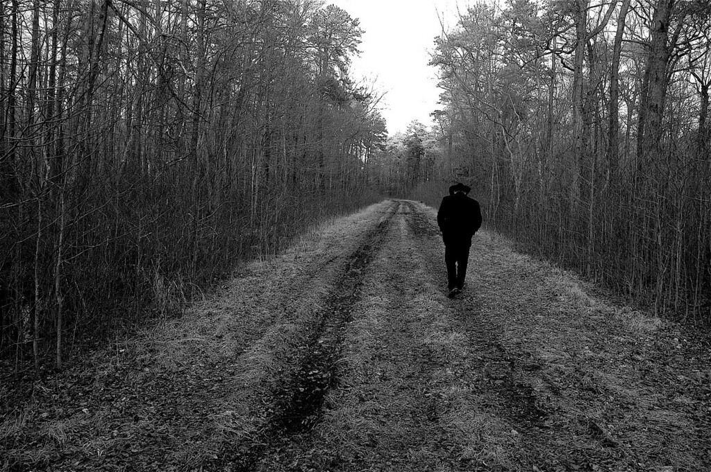 This Photo came in 2nd Place in a photo contest.  The subject was 'lonely road'<br /> It was titled 'lonely Man in Black'