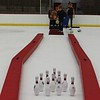 Tawana Roberts – The News-Herald<br> Mentor held its first Turkey Roll at the Mentor Civic Ice Arena on Nov. 18. Twenty teams of four developed a team name and a team uniform. Instead of using a bowling ball, the participants attempted to knock down the pins with a frozen turkey. Recreation Coordinator Maggie Kuyasa was pleased with the turnout noting that it was a sold-out event.