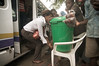 2009-12 Inchope - Passengers washing hands because of the Cholera outbreak.