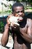 2008-52. Boy eating Coconut.