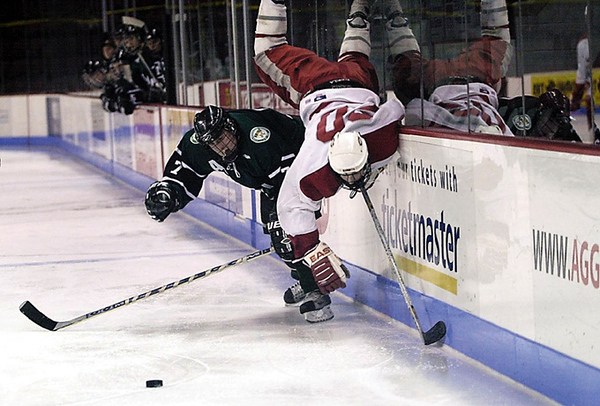 A Catholic Memorial player is upended during a game at Boston University's Agannis Arena.