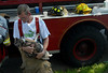 A Holliston firefighter holds a cat that was rescued from a housefire, Holliston, Mass.