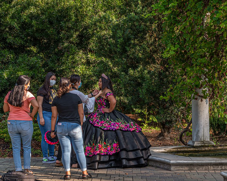 Friends and Family prepare for Quinceanera pictures