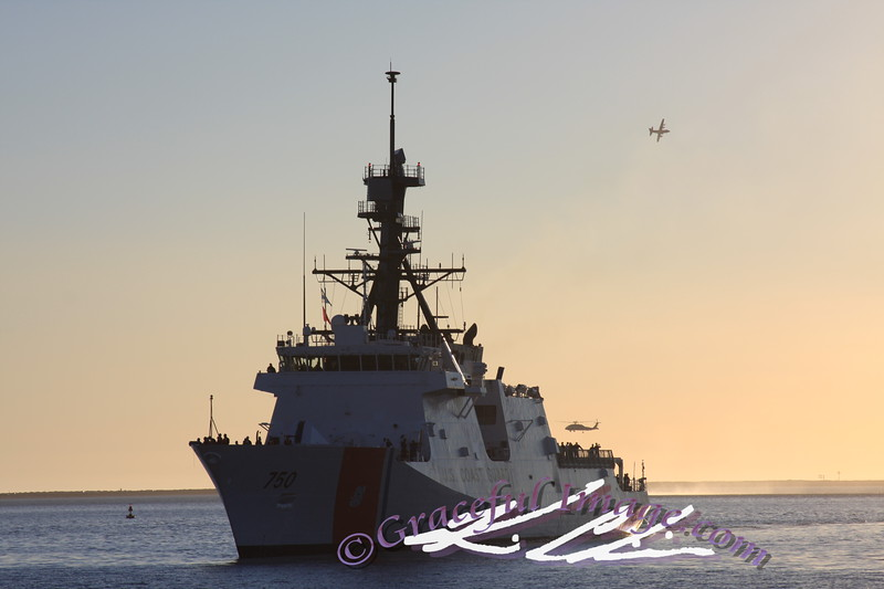 USCGC BERTHOLF pulling into port in San Diego.  A C130 and a blackhawk helecopter are seen in the background.