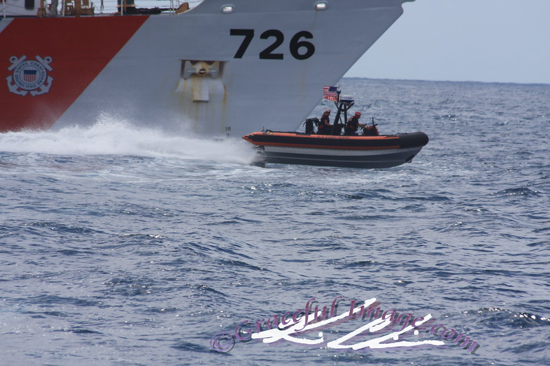 A RHI speeds past the USCGC MIDGETT (WHEC-726) in the pacific ocean