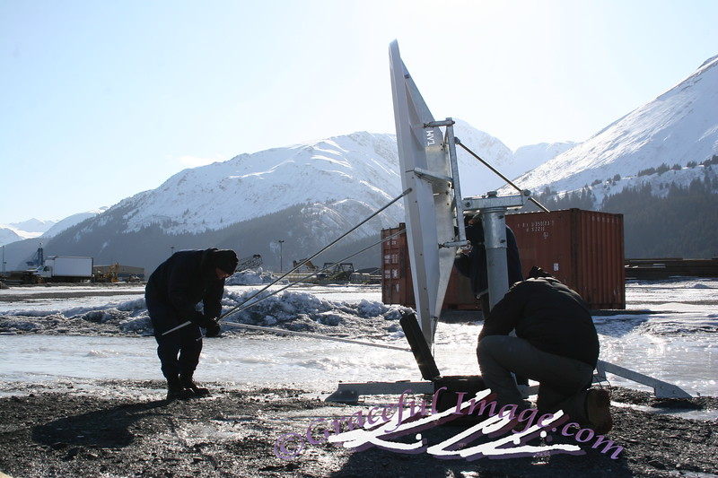 Setting up a 2.4 meter dish in the arctic for internet.
