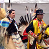 Chris Mourning Dove, left, a Cherokee, and Matthew White Eagle, a MicMaq, dance side by side in the grand entry at the Fourth Annual Circle Legacy Center Powwow in Memorial Park, Pottstown May 6, 2017.  (Bob Raines/Digital First Media)