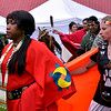 Ericka Wilder, left, Muskogee Creek, and Courtney Wolff, Oglala, Lakota and Blackfoot dance in the grand entry at the Fourth Annual Circle Legacy Center Powwow in Memorial Park, Pottstown May 6, 2017.  (Bob Raines/Digital First Media)