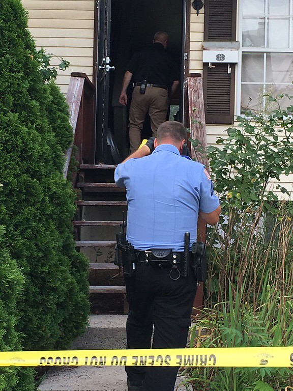 . Pottstown police investigate a home on the 400 block of Lincoln Avenue in Pottstown after a shooting incident involving a father and son. (Eric Devlin/Digital First Media)