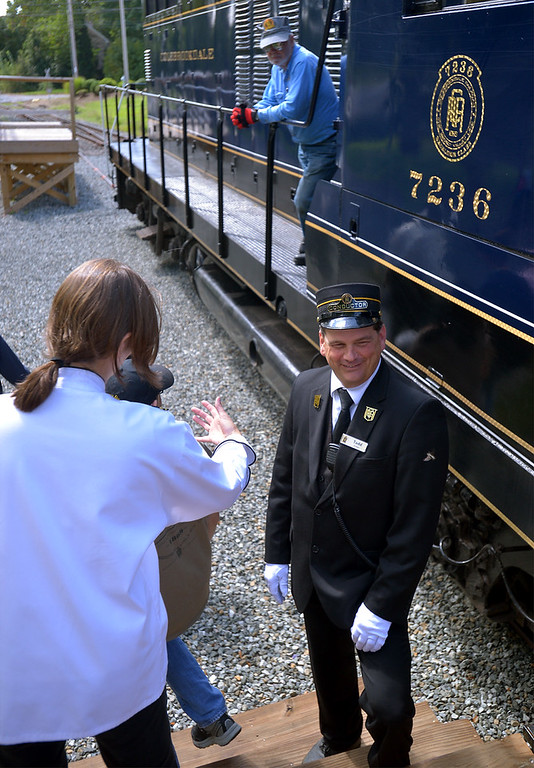 . A Colebrookdale Railroad conductor and engineer watch baseball players, their families and fans leave the platform at Memorial Park Sept. 9, 2017. / Bob Raines--Digital First Media