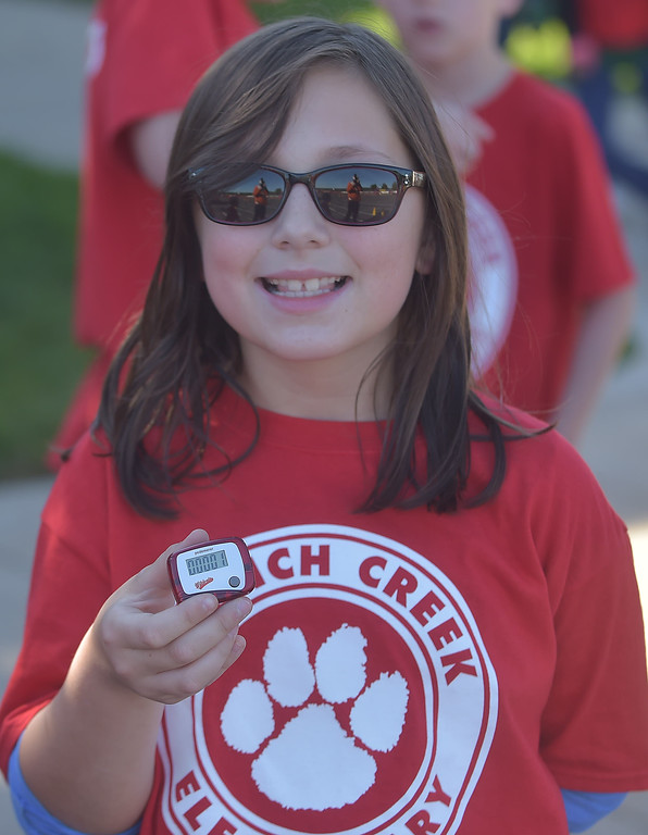. PETE BANNAN-DIGITAL FIRST MEDIA   French Creek Elementary student, Sarah Torrens is ready with her pedometer at the school\'s walk-a-thon on Oct. 18, the school PTA purchased each student and staff member a pedometer to encourage students as Chester County  worked to become the healthiest county in America.