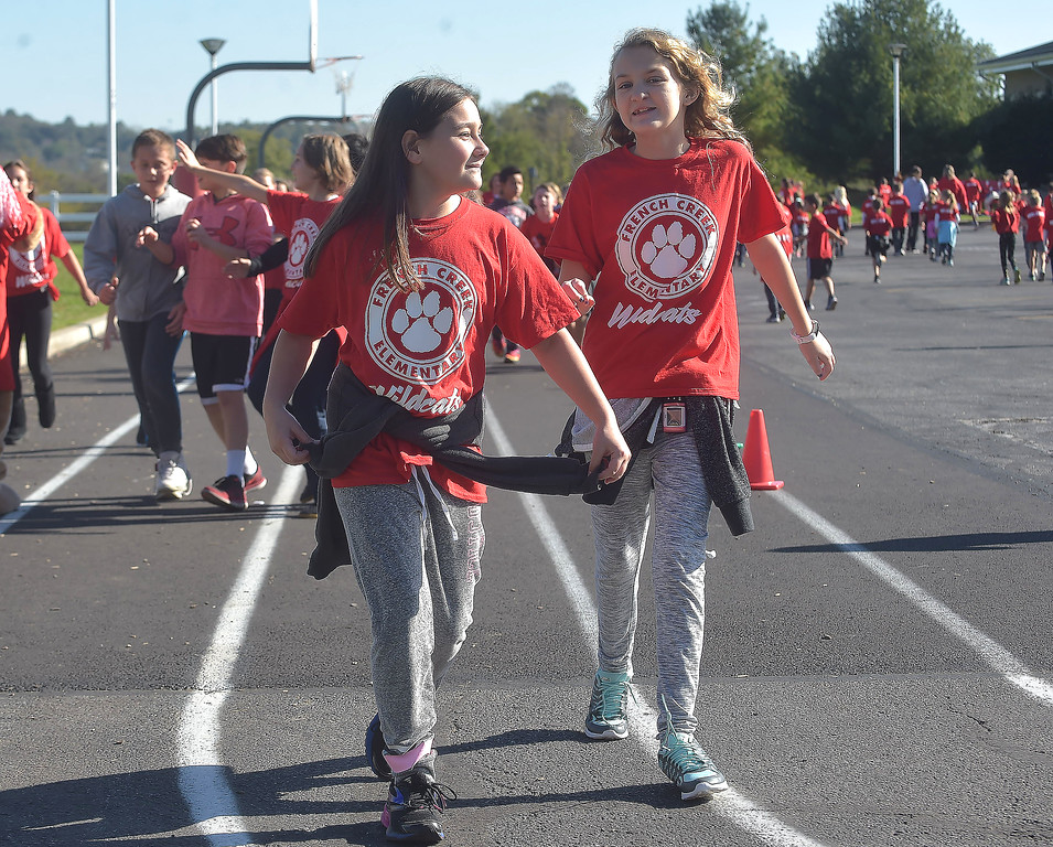. PETE BANNAN-DIGITAL FIRST MEDIA   French Creek Elementary School  students,Ally Williams and Julia Robinson took part in the school\'s walk-a-thon on Oct. 18, the school PTA purchased each student and staff member a pedometer to encourage students as Chester County  worked to become the healthiest county in America.