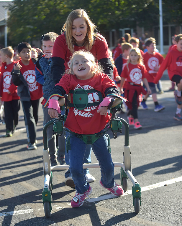 . PETE BANNAN-DIGITAL FIRST MEDIA   French Creek Elementary School,second grader, Lily Ciechoski and teachers aide, Cassie Dollard take part in the school\'s walk-a-thon on Oct. 18th, very grade took part in the program.