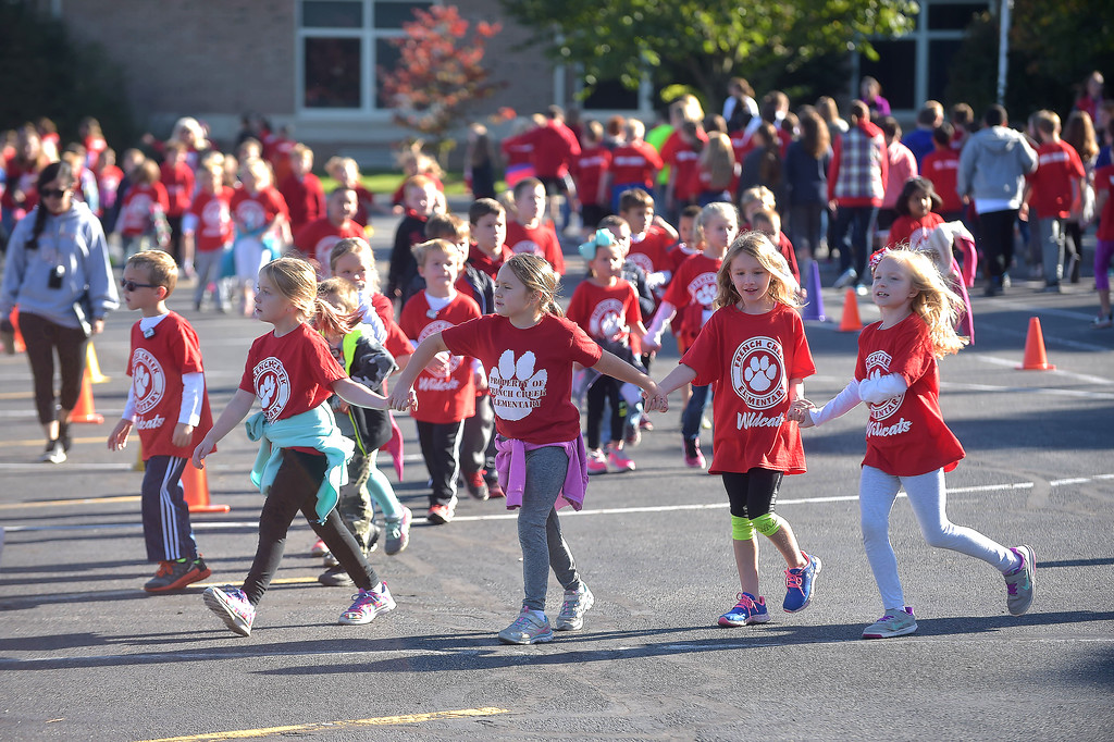 . PETE BANNAN-DIGITAL FIRST MEDIA   French Creek Elementary students take part in the school\'s walk-a-thon on Oct. 18, the school PTA purchased each student and staff member a pedometer to encourage students as Chester County  worked to become the healthiest county in America.