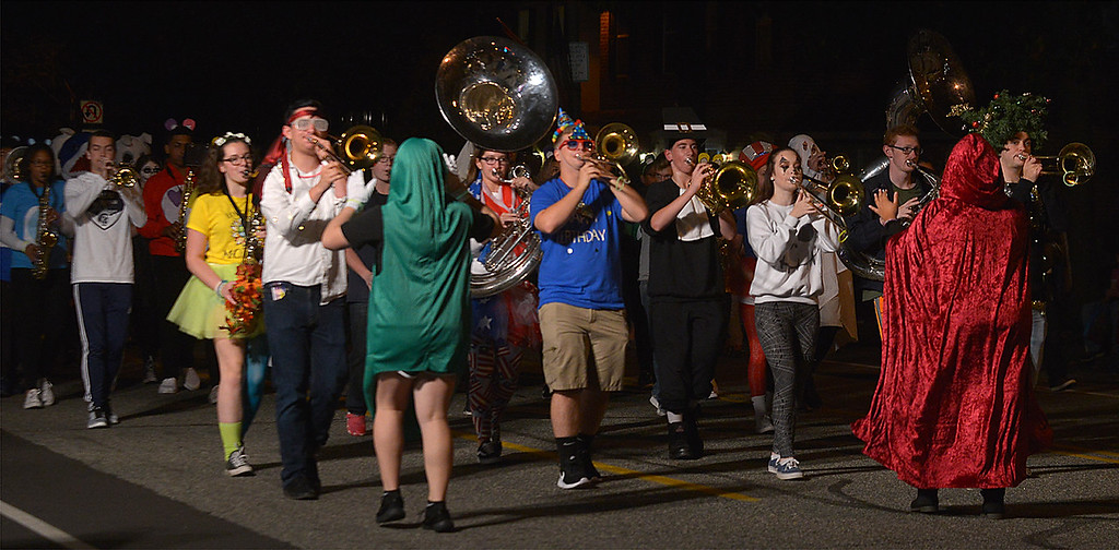 . The Pottstown High School Marching Band performs for spectators lining High St. Oct. 24, 2017. (Bob Raines--Digital First Media)