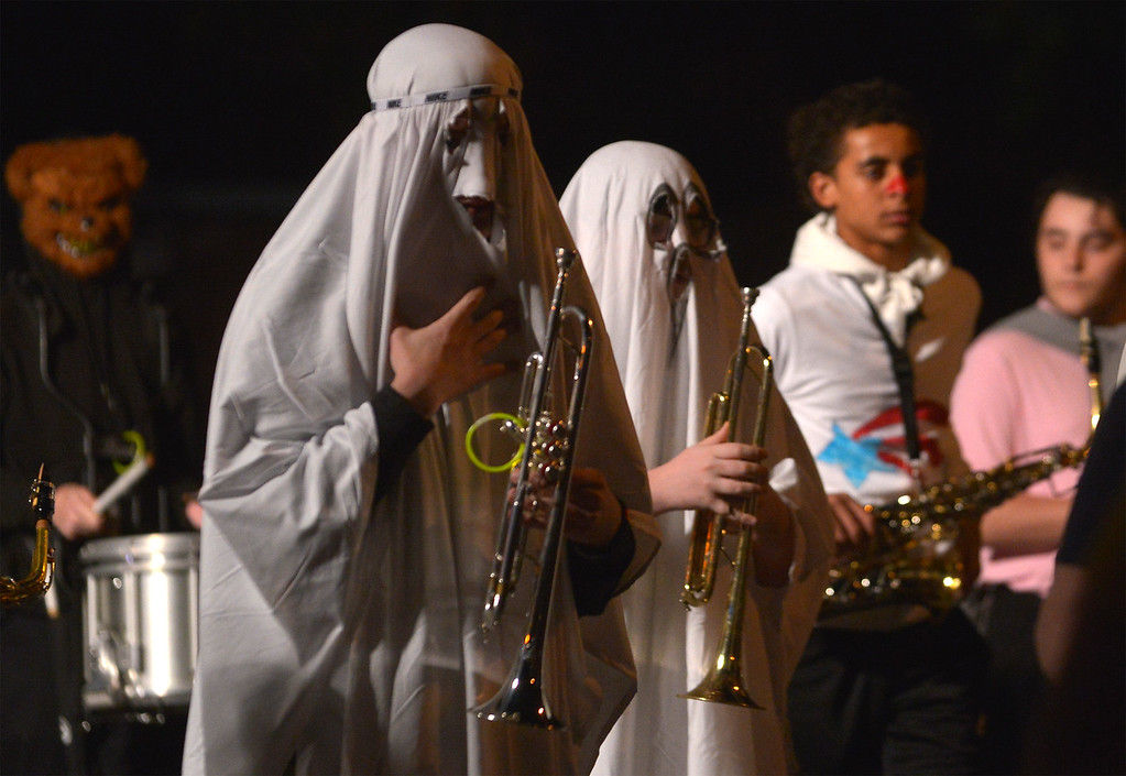 . Ghostly trumpeters walk with the Pottstown High School Marching Band Oct. 24, 2017. (Bob Raines--Digital First Media)