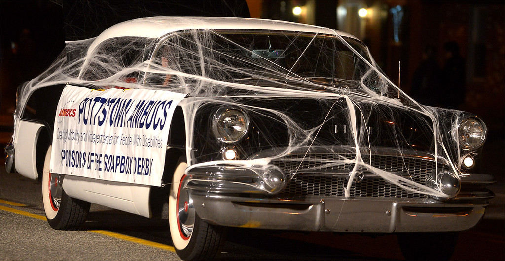 . The Pottstown AMBUCS made this vintage Buick look as though it tangled with a large spider for the Pottstown Halloween Parade Oct. 24, 2017. (Bob Raines--Digital First Media)