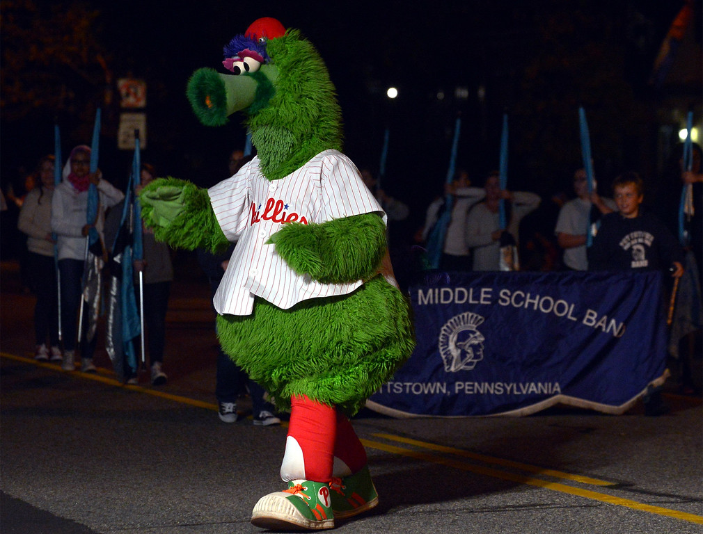 . The Phillie Phanatic leads the Pottstown Middle School Marching Band along High St. in the Pottstown Halloween Parade Oct. 24, 2017. (Bob Raines--Digital First Media)