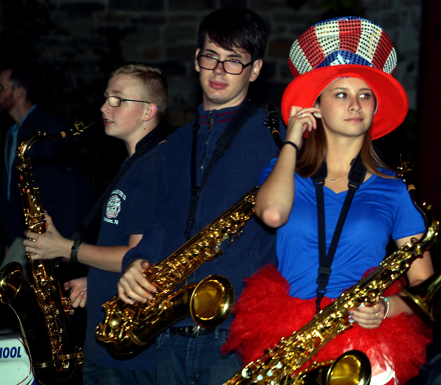 . Pottstown High School sax players wait for the  Halloween Parade to begin Oct. 24, 2017. (Bob Raines--Digital First Media)