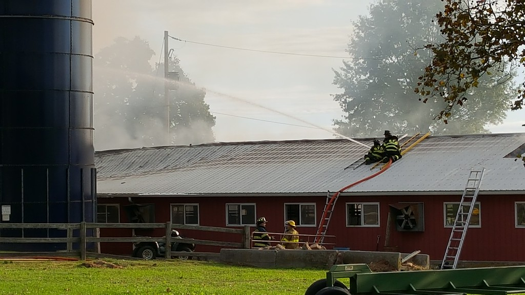 . Smoke can be seen coming up from a barn at Ridge Star Farm in Spring City. Marian Dennis -- Digital First Media