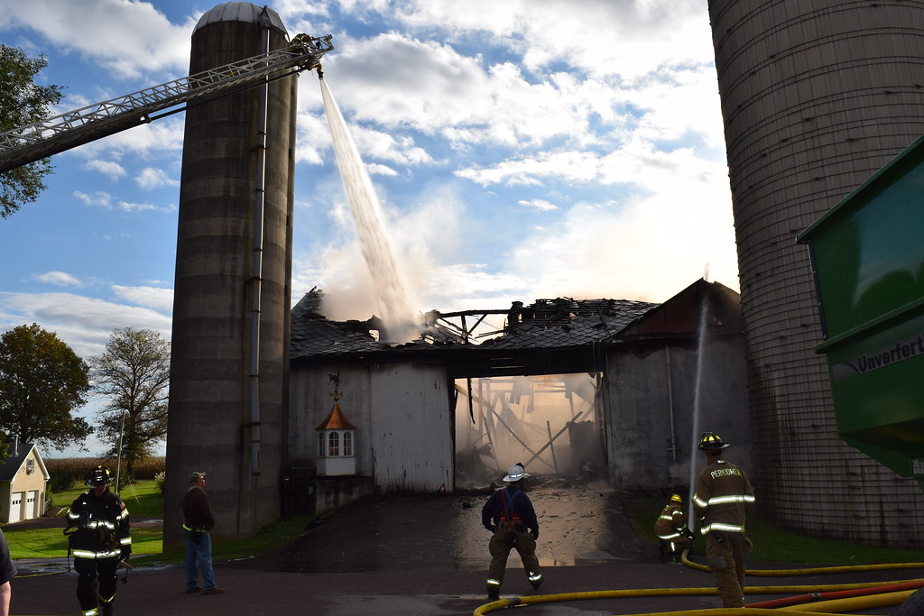 . Crews used ladder hoses to contain the fire that broke out at Ridge Star Farm early Wednesday morning. Marian Dennis -- Digital First Media