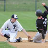 John Strickler - Digital First Media<br /> Pottstown's 31 Chase McKun puts the tag on Bear's 33 Ben Longacre who was out stealing second base in the top of the fourth inning.