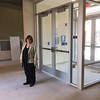 Judy Memberg, Executive Director of Genesis Housing Corp. in the entrance foyer to Beech Street Factory recently.