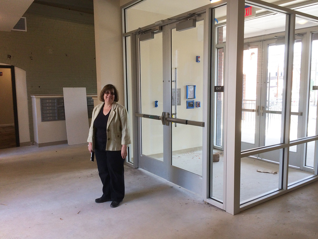 . Judy Memberg, Executive Director of Genesis Housing Corp. in the entrance foyer to Beech Street Factory recently.