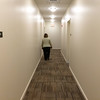 The first apartments to be open for rent will be in the four-story main section of the building. This is a hallway on the fourth floor.