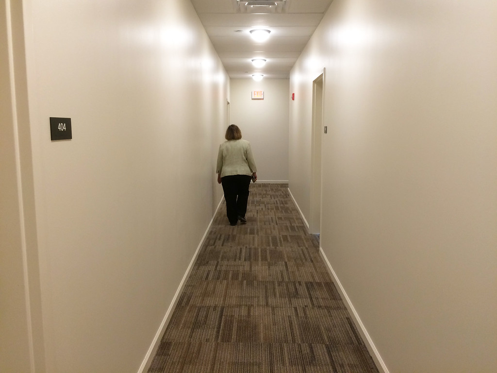 . The first apartments to be open for rent will be in the four-story main section of the building. This is a hallway on the fourth floor.