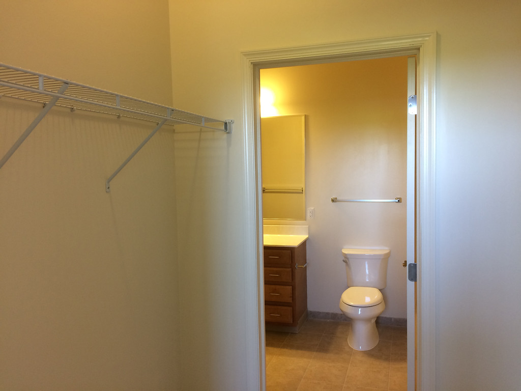 . The walk in closet in this one-bedroom also has a door to the bathroom, which has a second door off the hall.