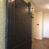 Although the building has a new modern elevator, contractors left the old freight elevator door as a decorative accent in the hall.