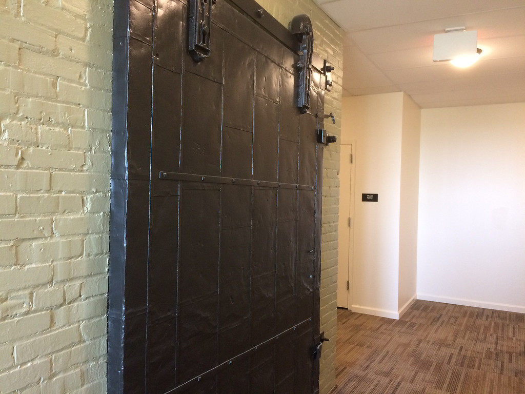 . Although the building has a new modern elevator, contractors left the old freight elevator door as a decorative accent in the hall.