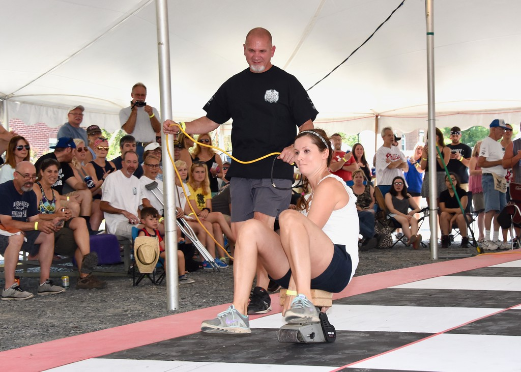 . Jesi Yost - Digital First Media  Cord Runner Bob DeLong and racing for the tenth year,  Erin Siegle. Cord Runner Bob DeLong offers this advice to racers, �Lean front (on the belt sander), it�s going to want to throw you back. Don�t walk your feet; try to glide on your heels.�