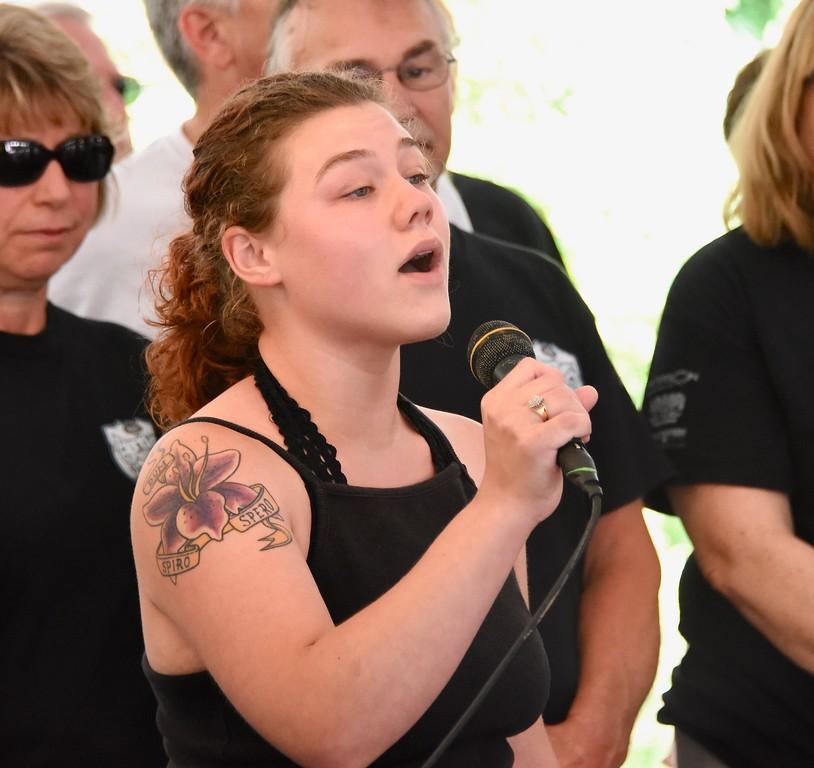 . Jesi Yost - Digital First Media  Katie Spencer sings the National Anthem.