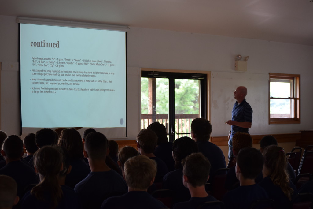 . Marian Dennis � Digital First Media Campers listened attentively Thursday during a presentation on drugs at Camp Cadet, a week-long program hosted by State Police Troop L.