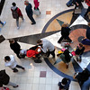A couple and their child pause as other shoppers swirl around them at King of Prussia Mall Nov. 24, 2017. (Bob Raines--Digital First Media)