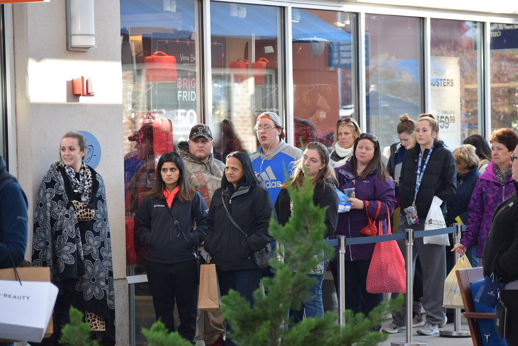 . Shoppers waited in line outside Kate Spade at the Philadelphia Premium Outlets in Limerick Friday for the once a year deals. Marian Dennis -- Digital First Media