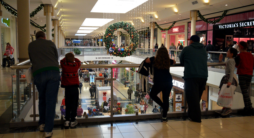 . Shoppers take a breather and watch other people shop at Montgomery Mall on Black Friday Nov. 24, 2017. (Bob Raines--Digital First Media)