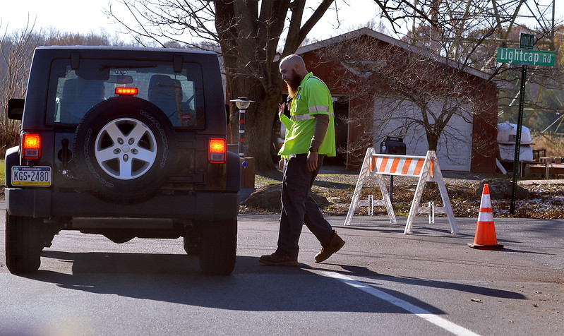 a<br /> A township worker blocking Lightcap Rd to traffic headed for Philadelphia Premium Outlets talks to a motorist about a detour Nov. 24, 2017. (Bob Raines--Digital First Media)