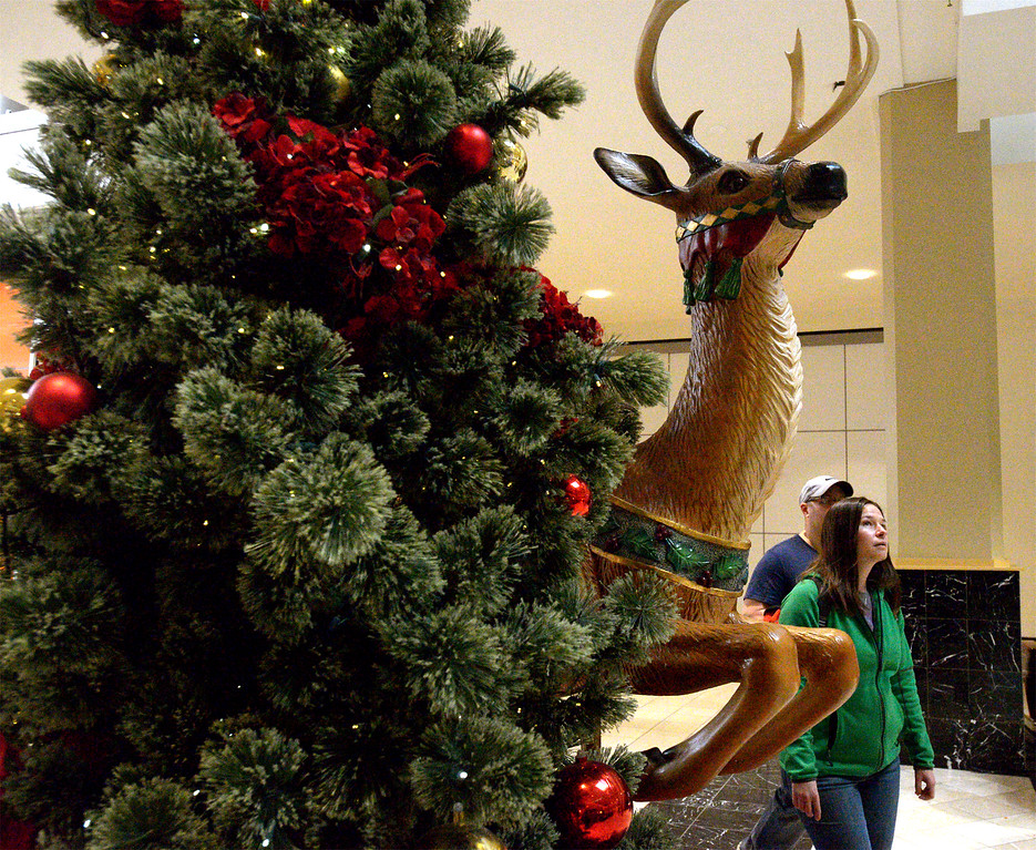 . A reindeer appears to leap past a Christmas tree at Montgomery Mall on Black Friday Nov. 24, 2017. (Bob Raines--Digital First Media)