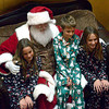 Three children came in pajamas to see Santa in Montgomery Mall on Black Friday Nov. 24, 2017. (Bob Raines--Digital First Media)