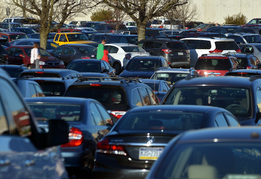 . Shoppers make their way threw a crowded parking lot at Montgomery Mall on Black Friday Nov. 24, 2017. (Bob Raines--Digital First Media)