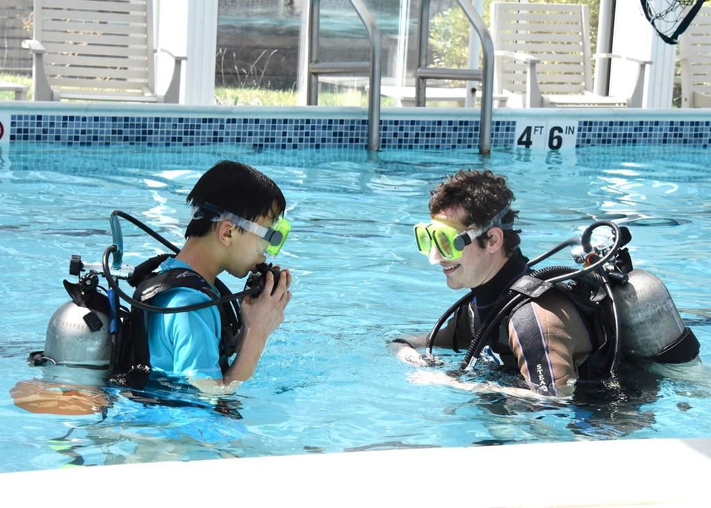 . Jesi Yost - Digital First Media  Wesley Harnish, 12, of Lebanon, with Adaptive Diving Association volunteer Dominic Pubbo.